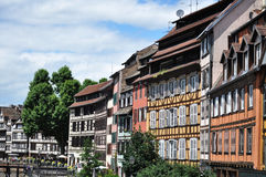 Traditional half timbered houses in Strasbourg, France. Traditional half timbered houses on a sunny day in the Petite France area of Strasbourg located in the stock image