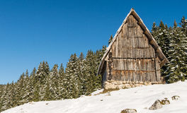 Traditional wooden hut in Alps Royalty Free Stock Photography