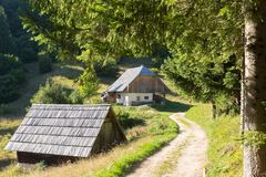 Free Traditional Wooden Hut Cabin In Mountain Alps At Rural Landscape In Slovenian Julian Alps, Slovenia. Stock Photos - 106734823