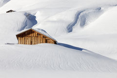 Traditional wooden hut in snow, Alps, Germany Stock Images