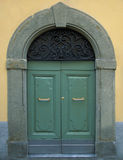 Traditional wooden Italian door with stone frame Royalty Free Stock Image