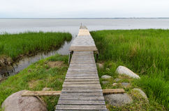 Traditional wooden jetty. By the coast of the island Oland in the Baltic Sea Royalty Free Stock Photos