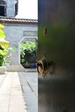 The traditional wooden long trip door of lingnan style architecture. ,the writting in the knocker is xi royalty free stock photo