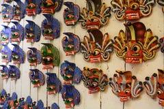 Traditional wooden masks on sale. Kandy. Sri Lanka Stock Photos