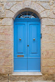 Traditional wooden painted blue door in Malta. Traditional wooden, vintage painted blue door in Malta Royalty Free Stock Photography