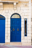 Traditional wooden painted blue door in Malta. Traditional wooden, vintage painted blue door in Malta Royalty Free Stock Image