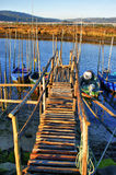 Traditional wooden pier stilts Stock Image