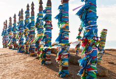Traditional wooden poles to the hitching post serge. Prayer flags on Olkhon, Buryat Region, Russia, Siberia. Stock Image