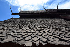 Traditional wooden roof. And blue sky background Stock Image