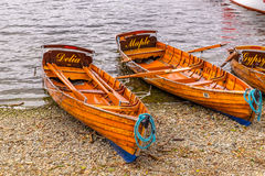 Traditional wooden rowing boats on lake windermere in the english lake district stock images