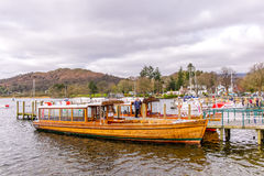 Traditional wooden rowing boats on lake windermere in the english lake district stock photos