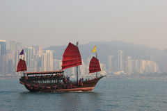 Traditional Wooden Sailboat sailing in Victoria Harbour in Hong Stock Photo