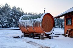 Traditional wooden sanitary bath-house in winter time. Lithuania Stock Photos