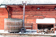 Traditional wooden sanitary bath-house in winter time. Lithuania Stock Images