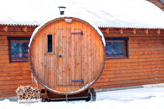 Traditional wooden sanitary bath-house in winter time. Lithuania Royalty Free Stock Photos