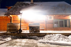 Traditional wooden sanitary bath-house in winter time. Lithuania Stock Photography