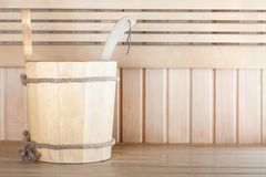 Traditional wooden sauna for relaxation with bucket Stock Photography