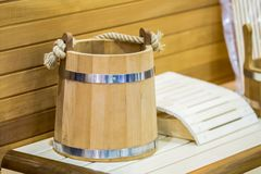 Traditional wooden sauna for relaxation with bucket of water. Interior of sauna and accessories. Traditional wooden sauna for relaxation with bucket of water Royalty Free Stock Photo