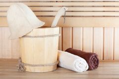 Traditional wooden sauna for relaxation with bucket Stock Photos