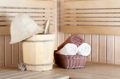 Traditional wooden sauna for relaxation with bucket of water Stock Image