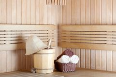 Traditional wooden sauna for relaxation with bucket of water Stock Photography