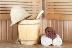 Traditional wooden sauna for relaxation with bucket of water Royalty Free Stock Photo