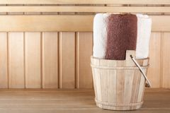 Traditional wooden sauna for relaxation with bucket of water Stock Photo