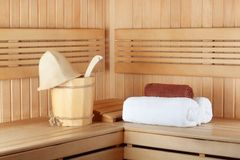 Traditional wooden sauna for relaxation with bucket of water Royalty Free Stock Image