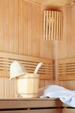 Traditional wooden sauna for relaxation with bucket of water Stock Photos