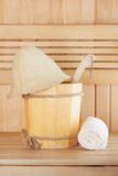 Traditional wooden sauna for relaxation with bucket of water Royalty Free Stock Photography
