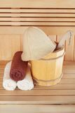 Traditional wooden sauna for relaxation with bucket of water Royalty Free Stock Photos