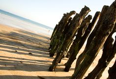Traditional wooden stakes at Saint-Malo Stock Image