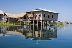 Traditional wooden stilt houses at the Inle lake Stock Photos