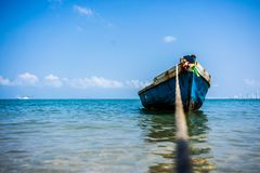 Traditional wooden thai boat dangles on the sea. Thailand. 4k. stock photo