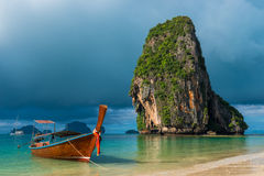Traditional wooden Thai boat near the shore Stock Image