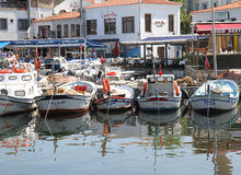 Traditional Wooden Turkish Fishing boats docked at Bozcaada port Stock Photo