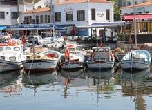 Traditional Wooden Turkish Fishing boats docked at Bozcaada port. BOZCAADA,TURKEY-JULY 30:Traditional Wooden Turkish Fishing boats docked at Bozcaada port.July Stock Photo