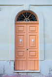 Traditional wooden painted orange door in Malta. Traditional wooden, vintage painted orange door in Malta Stock Images