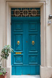 Traditional wooden painted turquoise door in Malta. Traditional wooden, vintage painted turquoise door in Malta Royalty Free Stock Images
