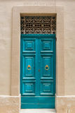 Traditional wooden painted turquoise door in Malta. Traditional wooden, vintage painted turquoise door in Malta Stock Photos