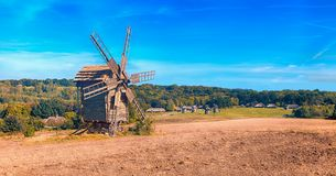 Traditional wooden windmill. In the middle of the field Royalty Free Stock Images