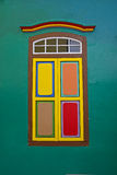 Traditional wooden window with leaf doors closed and colourful combination Royalty Free Stock Photos