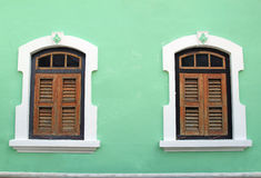 Traditional Wooden Window at Penang, Malaysia. Two traditional wooden windows with shutters at Penang, Georgetown, Malaysia Royalty Free Stock Photo