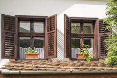 Traditional wooden windows. With opened wooden blinds Royalty Free Stock Photos