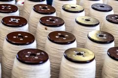 Traditional wool reels of the british waving and textile industry.  Stock Image