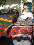 Traditional woven rugs stall at traditional ware fair at Romanian Peasant Museum in Bucharest, Romania on September 13, 2015 Royalty Free Stock Image