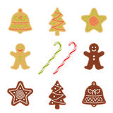 Traditional xmas cookies: gingerbread, christmas tree, star, bel. Traditional xmas cookies symbols: gingerbread man, christmas tree, star, bell and candy cane Stock Photo
