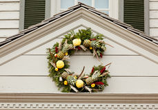 Traditional xmas wreath above front door Royalty Free Stock Image