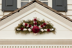 Traditional xmas wreath above front door Royalty Free Stock Photo
