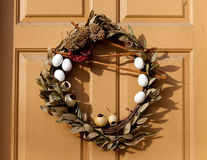 Traditional xmas wreath on front door. Traditional design of a christmas wreath attached to the front door of old house Royalty Free Stock Photo